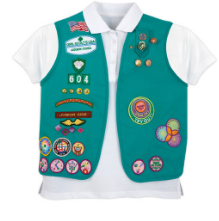 A photo of a green Girl Scout Junior uniform vest